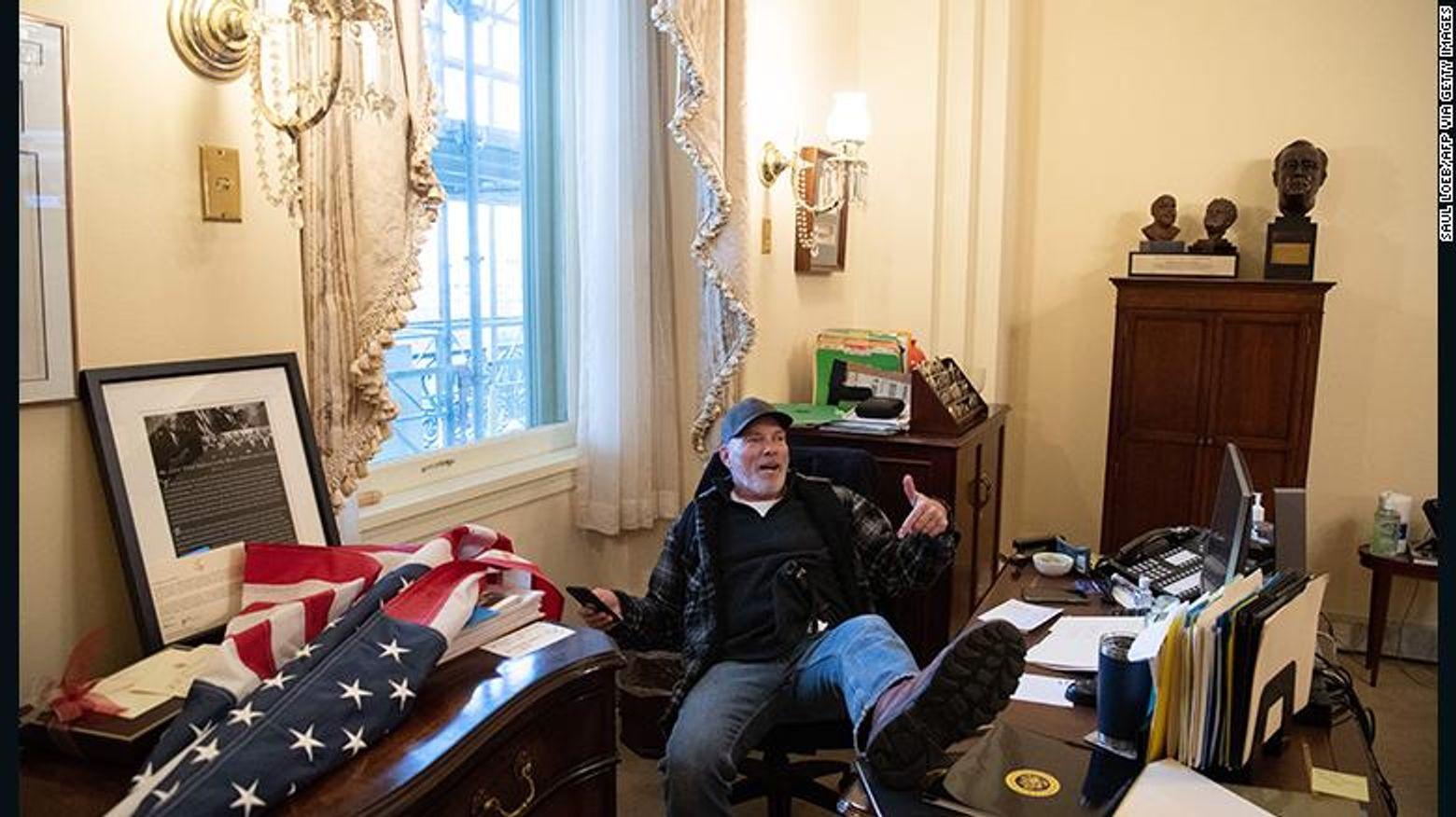 Richard Barnett sat inside the office of House Speaker Nancy Pelosi during the January 6 riot